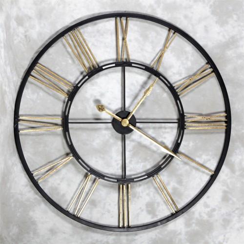 large black and gold metal skeleton clock